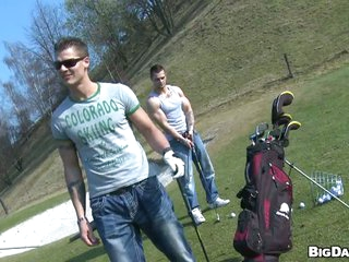 Muscular handsome studs tease each other in the golf proposition