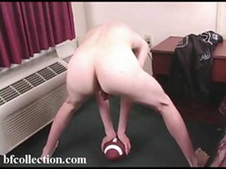 Cute boy playing with his football and his cock
