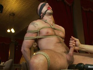 He is tied niggardly on that chair, blindfolded and ball gagged so he won't scream or see what happens to him. While his Hawkshaw is tied real permanent too, a dildo penetrates his anus and about to his penis is released from the ropes so it could be rubbed. He enjoys the intense handjob and moans with wonder