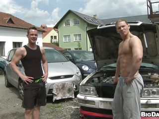 This sexy hunk got some violent looking muscles dancing around his perfect sexy body. While he is checking on some wheel under the hoods. Another horny guy comes apart from do some dirty talks and went down to suck his cock at one's fingertips that open yard. Later on the other guy gets down too and starts sucking cock.