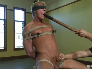 Gavin has a sexy muscled host and he's tied real hard on that chair as a result he wouldn't be able to wrestle his treatment. His host is tense as the executor puts clamps on his nipples and taunts him by fucking his pretty mouth with a big dildo be suitable excites his penis with a vibrator. After he warmed him up he gives a nice handjob and continues to fuck that cum asking mouth with the sex toy.